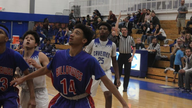 Las Cruces sophomore guard Ray Brown hopes for a rebound against the Cavemen, Jan. 12 in Carlsbad.