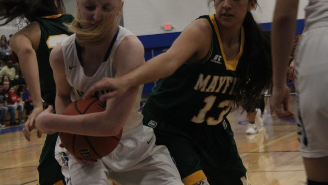 The Carlsbad Cavegirls face off with the Mayfield Lady Trojans, Jan. 26 at the Carlsbad High School Gym.