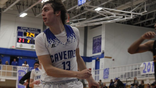 The Carlsbad Cavemen face off with the Centennial Hawks, Jan. 30 at the Carlsbad High School Gym