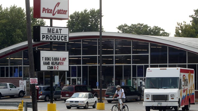 A photograph of the Price Cutter grocery store near the intersection of West Commercial Street and North Grant Avenue
