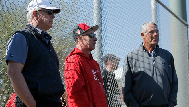 Former Red Buddy Bell (left) watches batting practice with Bill Doran (center) and former Reds manager Lou Piniella (right) during practice at the Cincinnati Reds training complex in Goodyear, Ariz., on Thursday, Feb. 22, 2018.