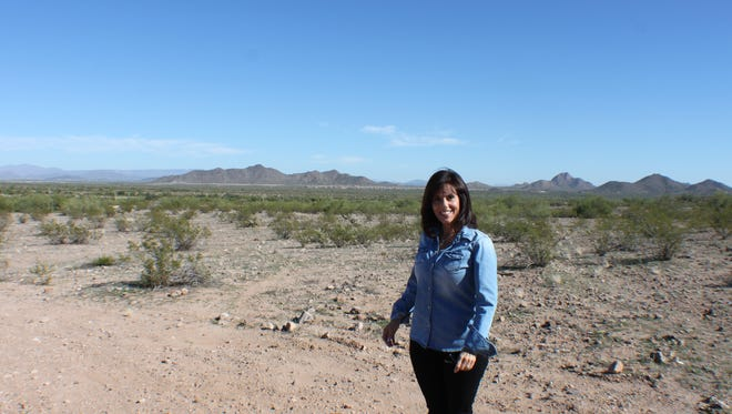 Peoria Councilwoman Bridget Binsbacher inspects the park site off Lake Pleasant Parkway near West Wing Mountain.