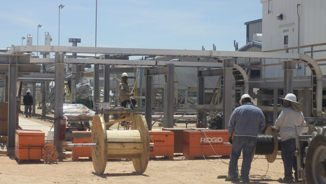 Workers maintain Sendero's natural gas processing plant, May 7, 2018 in Loving.