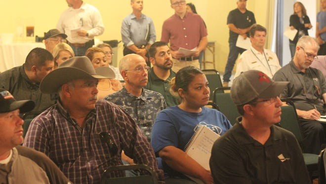 Local residents and industry officials attend a presentation on road work in Eddy County, May 23, 2018 at Riverside Country Club.