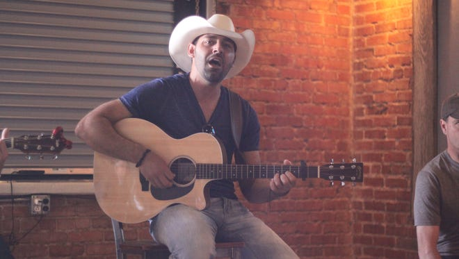 Canadian country singer Damien Maze performs a two-song set during before taking the stage at CavernFest, June 9, 2018 at Lucky Bull.