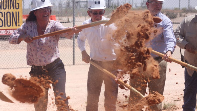 U.S. Assistant Secretary of Environmental Management Anne White tosses some dirt to signify the groundbreaking for a new ventilation system at the Waste Isolation Pilot Plant, June 14, 2018 at the WIPP site.