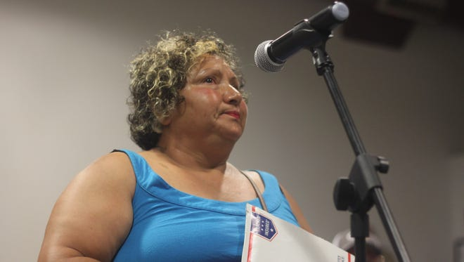 Lilia Santana talks about injuries her husband sustained in accident near the intersection of U.S. Highway 285 and New Mexico State Road 31 during a meeting, July 10, 2018 at the Eddy County Fire Service.