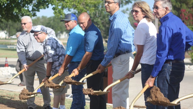 City officials and Potash industry leaders break ground on the future site of Potash Park, July 13, 2018 at the Pecos River Village Conference Center.