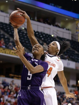Northwestern's Jordan Hankins (5) has her shot blocked by Maryland's Brianna Fraser (34) during the second half of an NCAA college basketball game at the Big Ten Conference tournament Saturday, March 5, 2016, in Indianapolis.