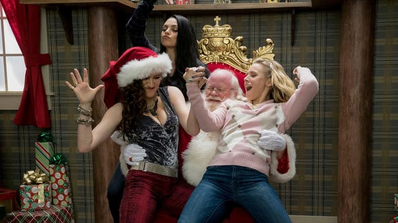 Santa is in for a big surprise when Kathryn Hahn, left,