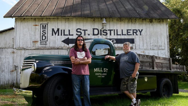 Carlos Ogden and Jeff Thompson are two of the three founding partners of Mill Street Distillery in Utica.