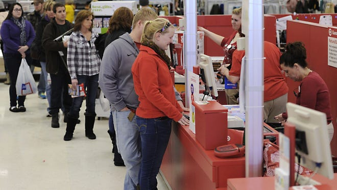 People return items at Target in Summit Township, Pa., the day after Christmas 2013.