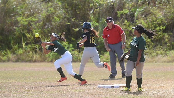 The defending champion John F. Kennedy Islanders faced off against the Tiyan High School Lady Islanders during their Independent Interscholastic Athletic Association of Guam Girls Softball League opening game at JFK High School on Jan. 20, 2018. The Islanders defeated the Lady Titans 16-1, ending the game by a mercy rule in the fourth inning.