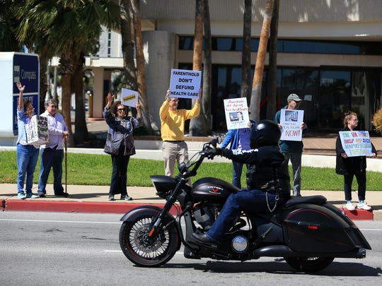 Protesters gathered outside U.S. Rep. Blake Farenthold's office Saturday, February 25, 2017 to protest a variety of issues, including the repeal of the Affordable Care Act.
