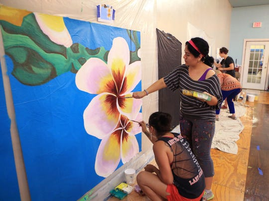 Mayra Zamora (left) and Sandra Gonzalez, instructors for the K Space Contemporary summer art camp focused on mural arts, works on a mural panel on Friday, June 30, 2017 in Corpus Christi, TX. Students participating in the camps are painting and installing a mural in a parking garage downtown. The one-week camp will be held five times this summer. Each week a portion of the mural will be installed.