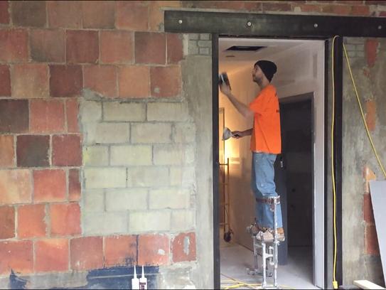 Mark Brown of Richmond-based Leblanc Drywall touches