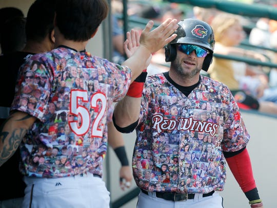 Red Wings' Matt Hague is congratulated by the team after his home run against Pawtucket in the third inning for a 2-0 lead at Frontier Field.