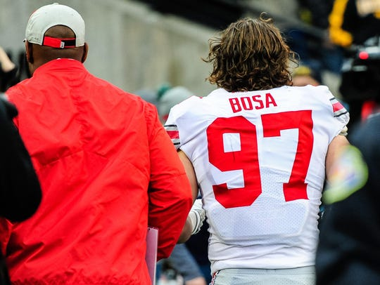 Ohio State defensive end Nick Bosa is escorted from