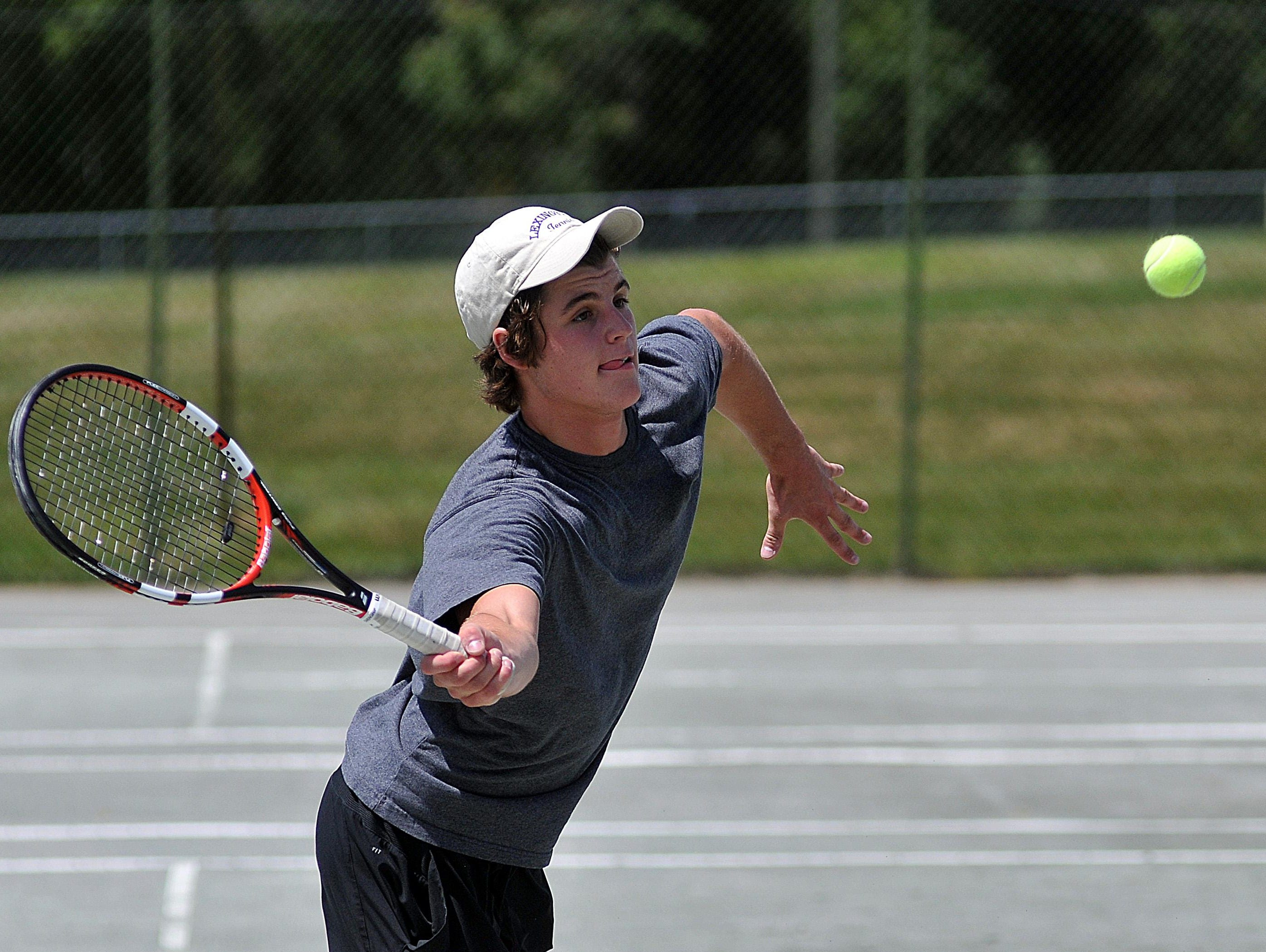 Matt Youse his a forehand during action Saturday in the 82nd News Journal/Richland Bank Tennis Tournament.