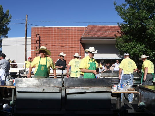 Members of the Asphalt Cowboys serve food during the