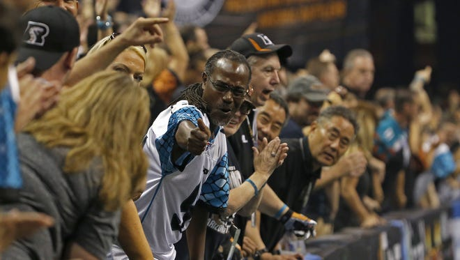 Rattlers fans celebrate against the Gladiators at Talking Stick Resort Arena on August 13, 2016 in Phoenix, Ariz.