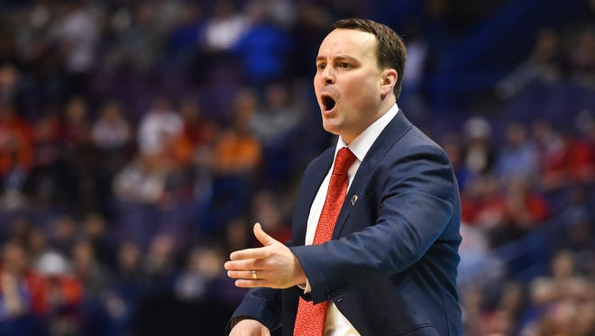 Dayton Flyers coach Archie Miller looks on during the first half of the first round against the Syracuse Orange in the 2016 NCAA Tournament at Scottrade Center.