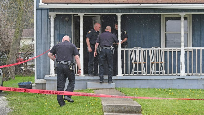 Mansfield Police investigate the scene of a shooting Thursday afternoon at 737 North Bowman Street.