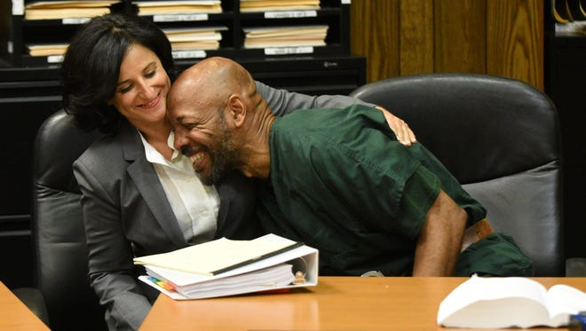 Vanessa Potkin of the Innocence Project hugs Eric Kelley in court on Sept. 15. Kelley and Ralph Lee, who have spent more than two decades in prison, were convicted of killing Tito Merino, a video store clerk in Paterson, in 1993. But now there is new DNA evidence being presented by the Innocence Project.