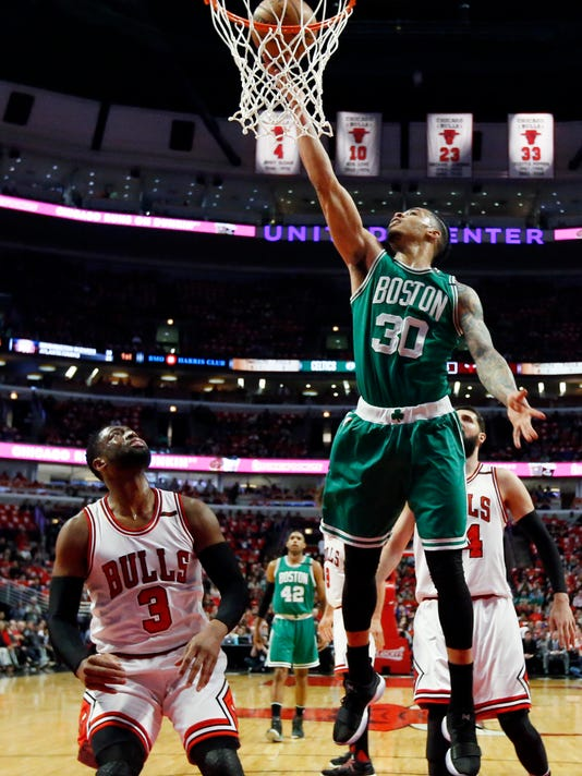 Boston Celtics guard/forward Gerald Green (30) drives to the basket as Chicago Bulls guard Dwyane Wade (3) watches during the first half in Game 6 of an NBA basketball first-round playoff series, Friday, April. 28, 2017, in Chicago. (AP Photo/Nam Y. Huh)