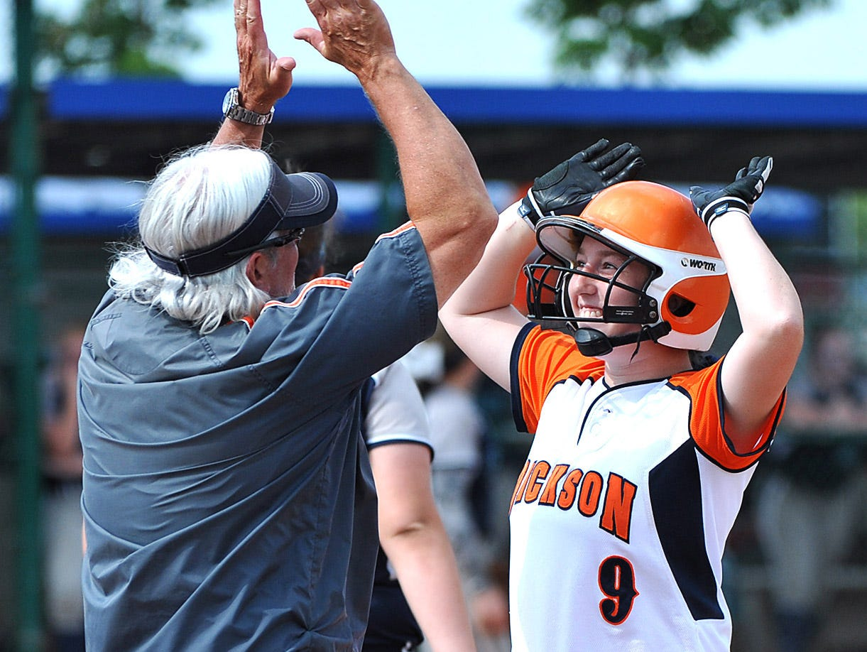 Coach Bert Newberry congratulates Paige Sensing after an RBI single in the Class AAA championship game on May 27, 2016.