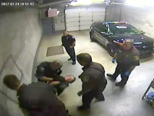 Tiffany McNeil is suing Coldwater, Mich. police after she said she was slammed to the ground and injured during her arrest on July 24, 2017.
