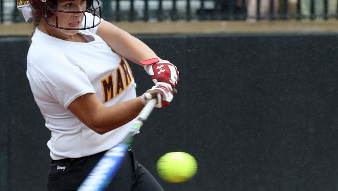 Farmington Hills Mercy #3 Cari Padula hits a single in her teams game against Mattawan on June 16, 2016 at the MHSAA softball semi finals at Michigan State University in East Lansing, Michigan.Mercy won the game 9-6 to reach the division 1 finals on Saturday.Eric Seals/Detroit Free Press