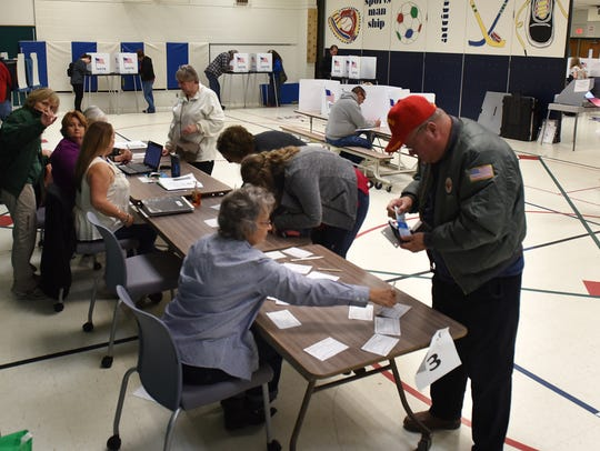Voters cast their ballots at precinct 3 of Highland