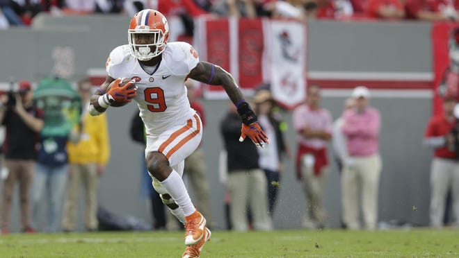 Clemson's Wayne Gallman runs the ball against North Carolina State on Saturday, Oct. 31. Clemson was ranked No. 1 in the first College Football Playoff ranking of the season.
