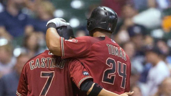 Arizona Diamondbacks' Yasmany Tomas is greeted by Welington Castillo after hitting a two-run home run, his second homer of the baseball game, off Milwaukee Brewers' Jimmy Nelson during the fifth inning Wednesday, July 27, 2016, in Milwaukee.