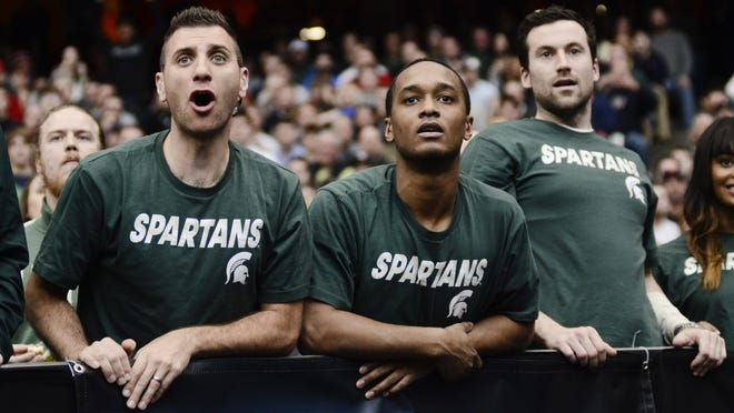 Michigan State fans react during the second half of a regional final against Louisville in the NCAA men's college basketball tournament Sunday, March 29, 2015, in Syracuse, N.Y. (AP Photo/Heather Ainsworth)