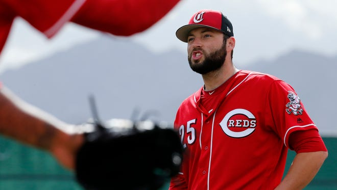 Cincinnati Reds relief pitcher Cody Reed (25) waits his turn during drills at the Cincinnati Reds training complex in Goodyear, Ariz., on Monday, Feb. 19, 2018.