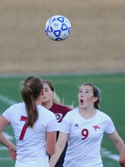 Cooper's Honna Turner (9) eyes the ball as teammate Courtney Osborne (9) and a Midland Lee player look on. Cooper beat the Lady Rebels 2-1 in a nondistrict girls soccer game Tuesday, Jan. 24, 2017 at Shotwell Stadium.
