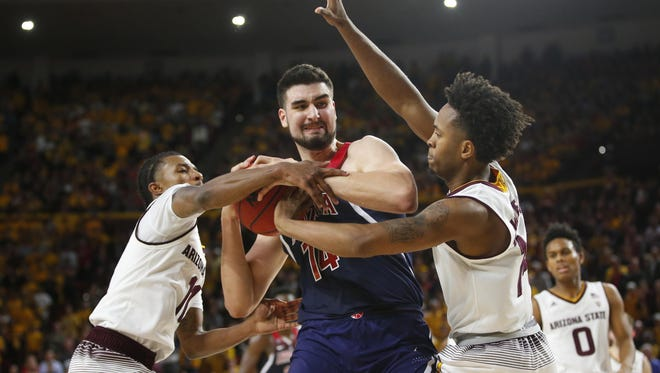 Arizona State Sun Devils guard Shannon Evans II (11) and forward Kimani Lawrence (14) guard Arizona Wildcats center Dusan Ristic (14) during a men's basketball game at Wells Fargo Arena in Tempe on February 15, 2018. #asu basketball