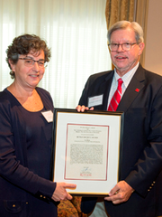 Lisa C. Klein receiving a 2015 Human Dignity award from Richard L. Edwards, chancellor of Rutgers-New Brunswick.
