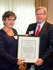 Lisa C. Klein receiving a 2015 Human Dignity Award from Richard L. Edwards, chancellor of Rutgers-New Brunswick.