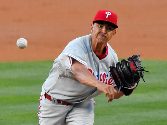 Philadelphia Phillies starting pitcher Severino Gonzalez throws to the plate during the second inning of a baseball game against the Los Angeles Dodgers, Thursday, July 9, 2015, in Los Angeles. (AP Photo/Mark J. Terrill)