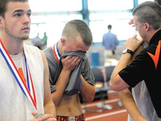 York Suburban senior Justin Corsa and teammates become emotional after falling to Bethlehem Catholic in the PIAA Class AA boys' volleyball final Saturday.