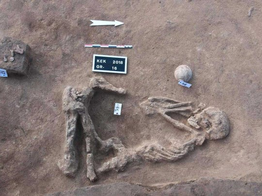This undated handout photo provided by the Egyptian Antiquities Authority, shows a skeleton, at the Kom al-Kholgan archaeological site, about 87 miles north of Cairo, Egypt. The Antiquities Ministry said archaeologists have uncovered ancient tombs dating back to the Second Intermediate Period, 1782-1570 B.C., in the Nile Delta.