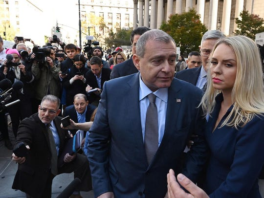 Lev Parnas, middle, a Ukrainian-American businessman who is both a client and associate of Rudy Giuliani, leaves with his wife, Svetlana Parnas, after his arraignment in the Southern District of New York on October 23, 2019. (Timothy A. Clary/AFP/Getty Images/TNS)