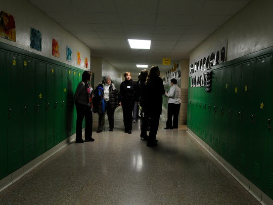 Families take a tour during a 2009 open house the Wisconsin International School in De Pere.