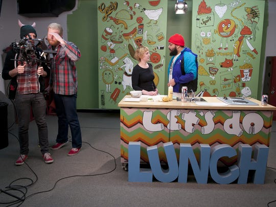 """Camera operator Chris Fry and producer Jeremy Tubbs adjust camera settings as Bluebeard head chef Abbi Merriss and host Oreo Jones discuss choreography before filming an episode of local cooking show """"Let's Do Lunch with Oreo Jones"""" at the Westgate studio on West 10th Street, Tuesday, Dec. 16, 2014."""