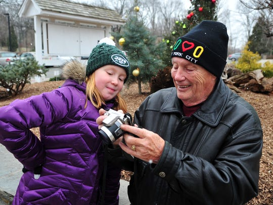Jolie Parisi, 10, of Mount Arlington, and her grandfather Don Devine of Mine Hill check out the photos they shot during the Frelinghuysen Arboretum's Winter Weekend Photo Scavenger Hunt.