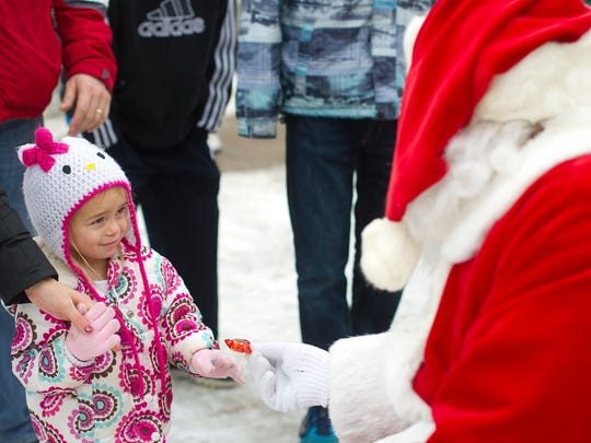 Megan Hembree, 3, of Elkhorn receives a piece of candy
