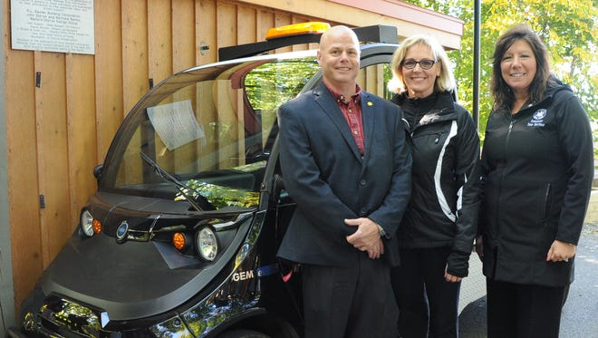 Walkway Park Manager Eric Hoppe, Walkway Executive Director Elizabeth Waldstein-Hart, and Sen. Sue Serino pictured here with an electric maintenance vehicle.
